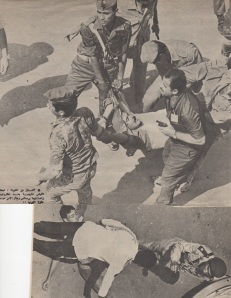 Wounded Lt Islambouli is dragged away. another assailant was wounded in the stomach but survived