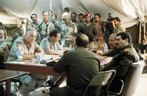 The photo above was taken on March 3, 1991, at Safwan, Iraq. Visible in the image are Gen. H. Norman Schwarzkopf, the commander in chief of US Central Command, along with Saudi Lt. Gen. Khalid Bin Sultan, commander of the Joint Arab­Islamic Force, sitting next to him. Accross the table, facing them, are officers from the Iraqi delegation. (photo courtesy of globalsecuirty.org