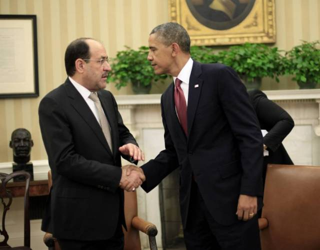 President Barack Obama shakes hands with Iraqi Prime Minister Nouri al-Maliki following their meeting in the Oval Office of the White House in Washington 2013 | AP