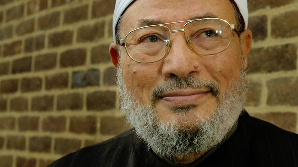 ISLAMIC SCHOLAR AL-QARADAWI POSES IN LONDON.